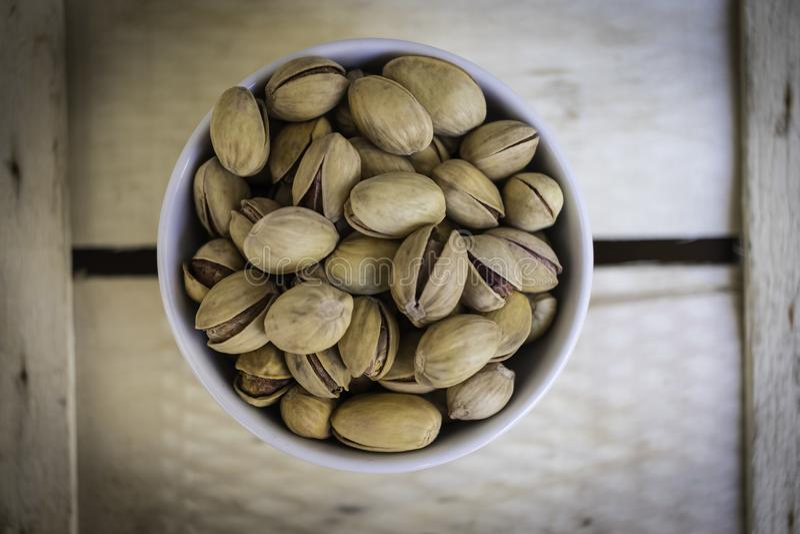Bowl full of delicious Sicilian pistachios stock photos