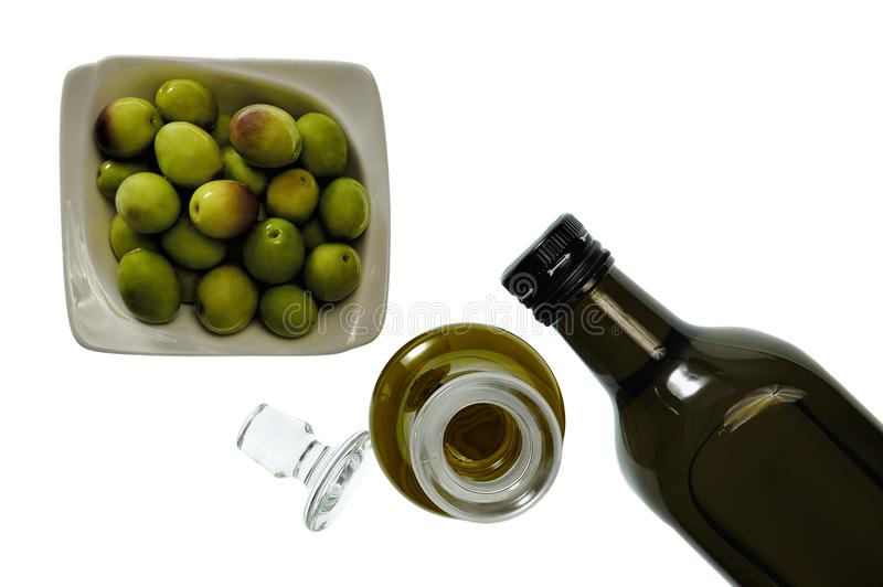 Close up of a bowl of olive and extra virgin olive oil in bottle royalty free stock image