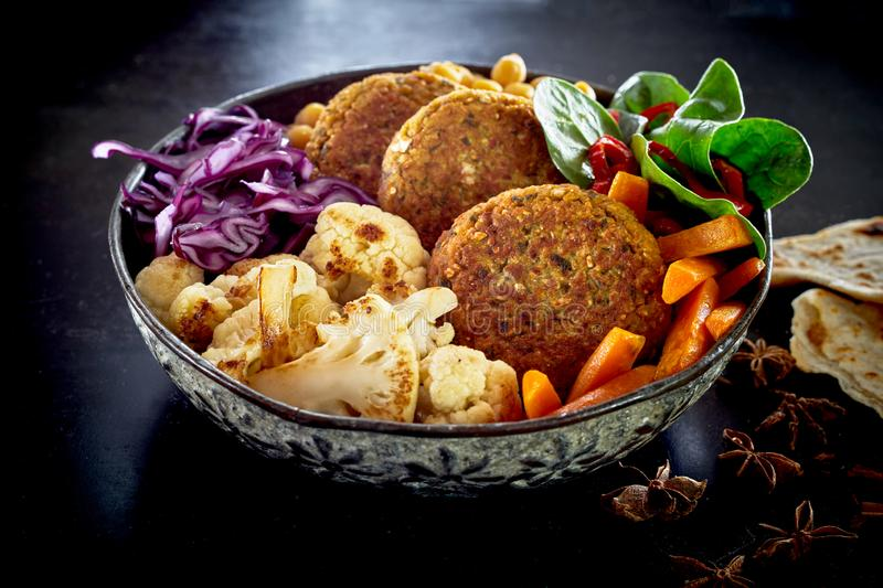Close-up on bowl of vegetables and cutlets royalty free stock images