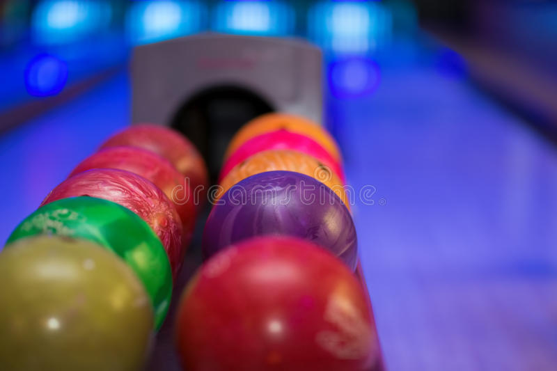 Close up of bowling balls. With bowling lane in the background stock photography
