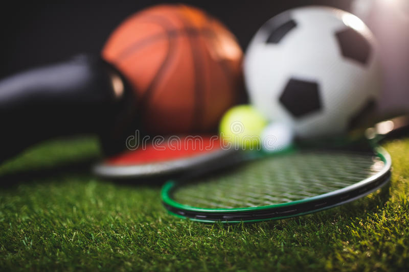 Close up of boxing gloves and basketball football tennis golf balls and discus stock photography