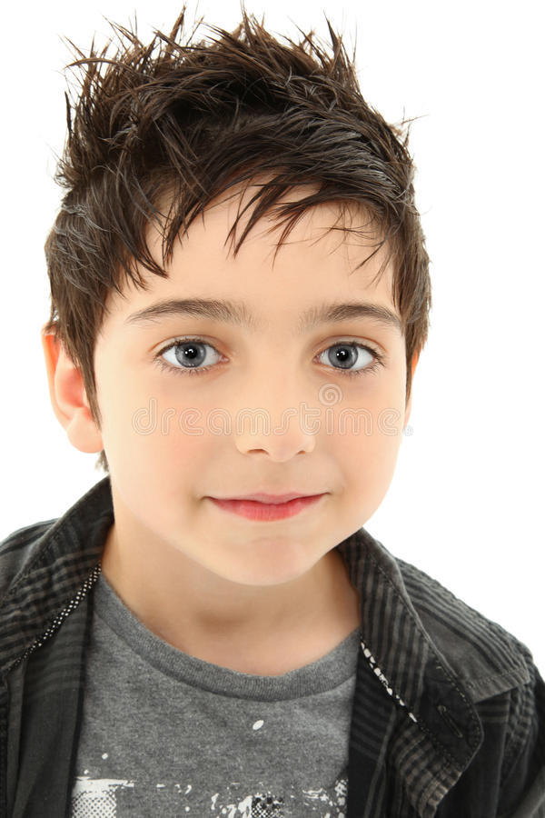 Close Up Boy with Hazel Eyes. Close up young boy slight smile, hazel eyes, spiky, brown hair over white royalty free stock images