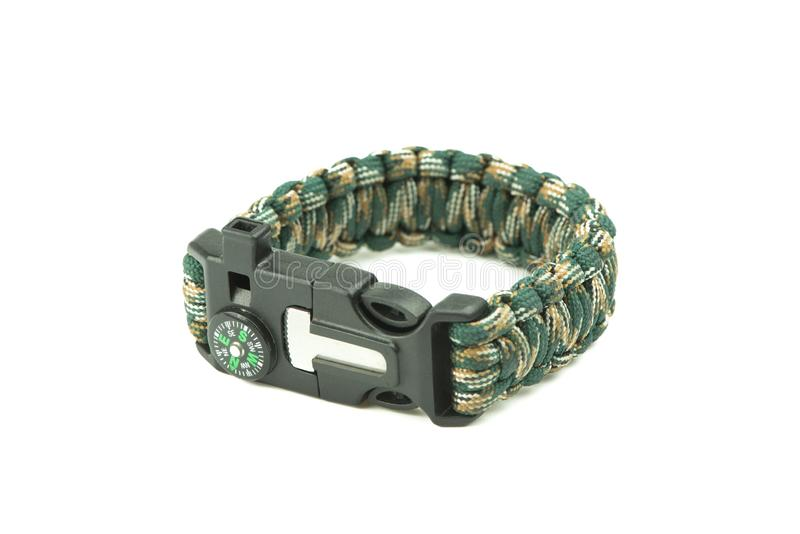 Close-up of braided camouflage para cord bracelet on white. stock photos