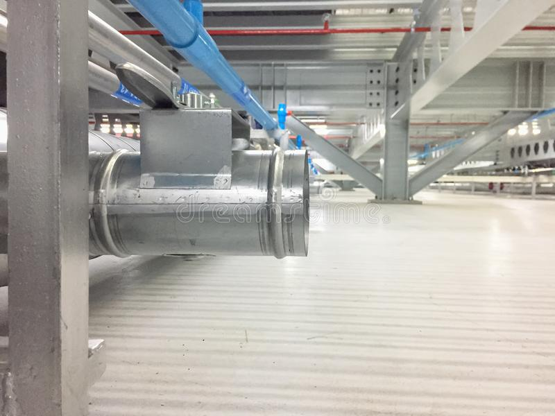 Close up of branch of exhaust under raised floor.  stock photos