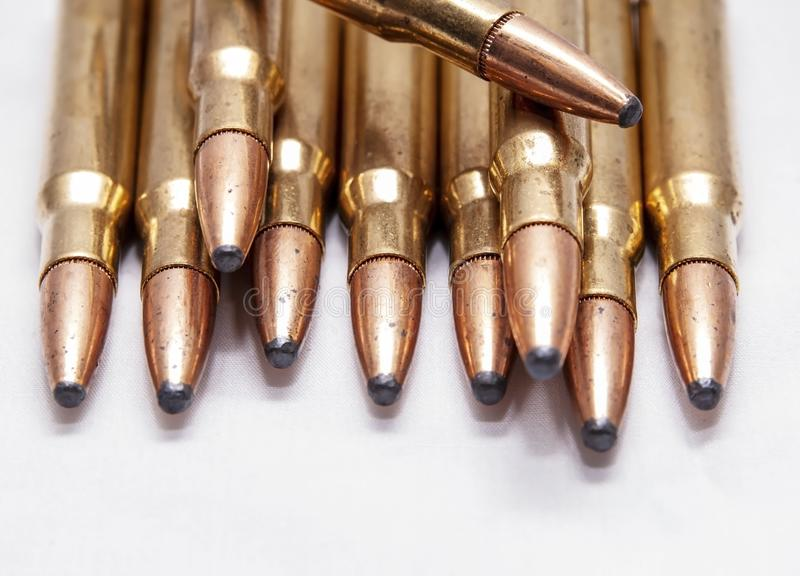 A close up of brass rifle bullets used for hunting. On a white background royalty free stock photos