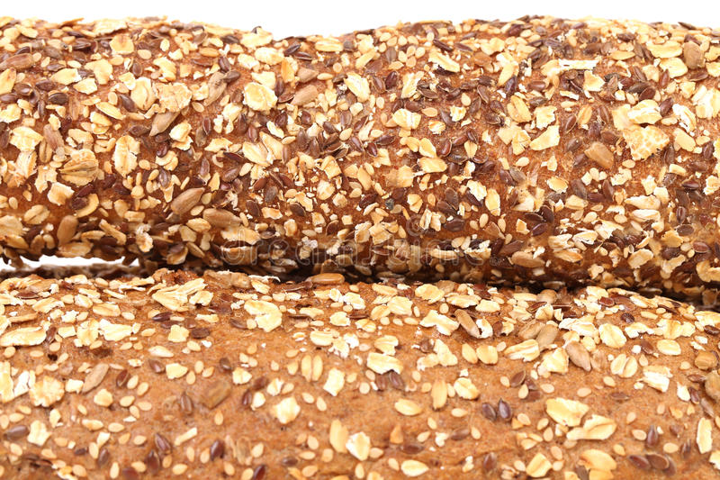 Close up of bread made from whole grain. Whole background royalty free stock images