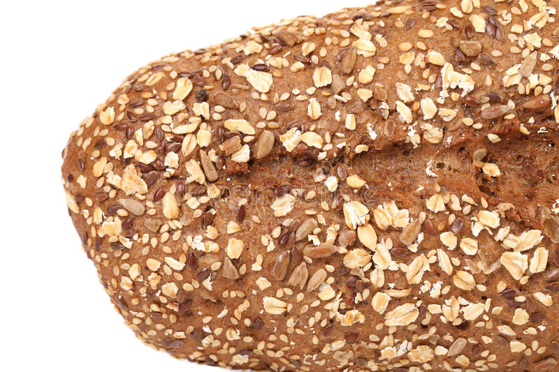 Close up of bread made from whole grain. Isolated on a white background stock photography