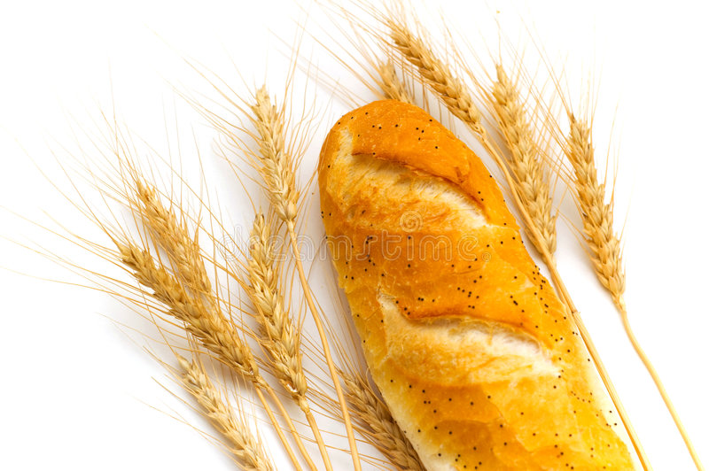 Close up of bread and wheat ears royalty free stock photos