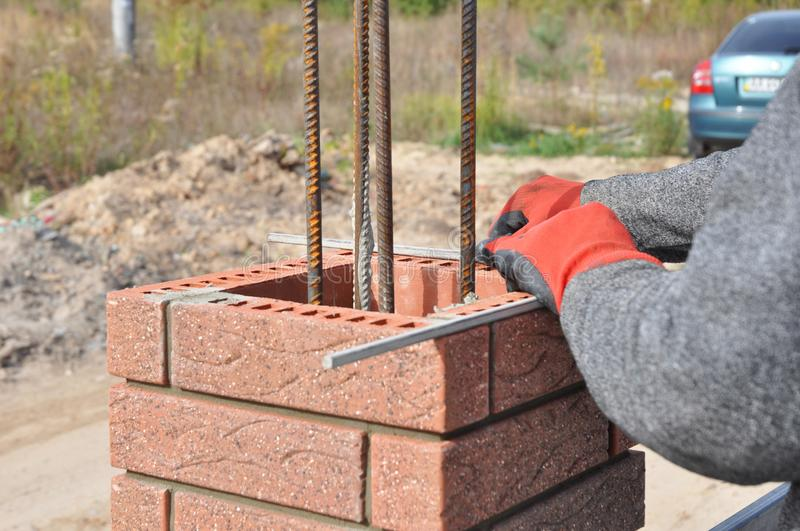 Close up on brick laying blocks correctly on fence brick column. Whether you are laying brick to build a mailbox enclosure royalty free stock image