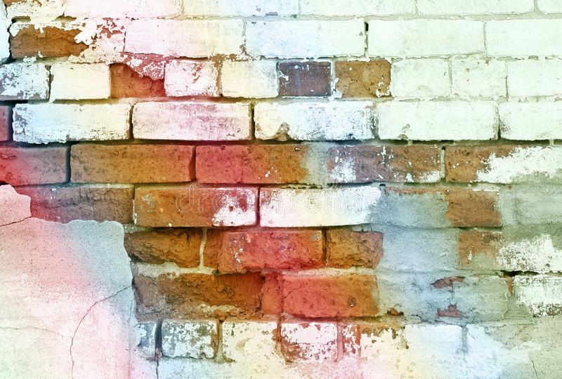 Close up of a brick wall in need of repair with cracking and peeling paint royalty free stock images