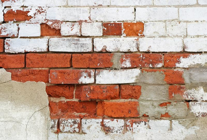 Close up of a brick wall in need of repair with cracking and peeling paint stock images