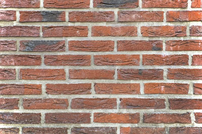 Close up of brick wall of red color. Old bricks with fire traces. Perfect background stock photo