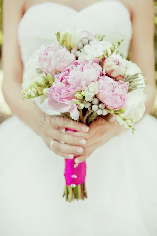 Close-up bridal bouquet of spring pink and white flowers on a blurred background, selective focus stock images