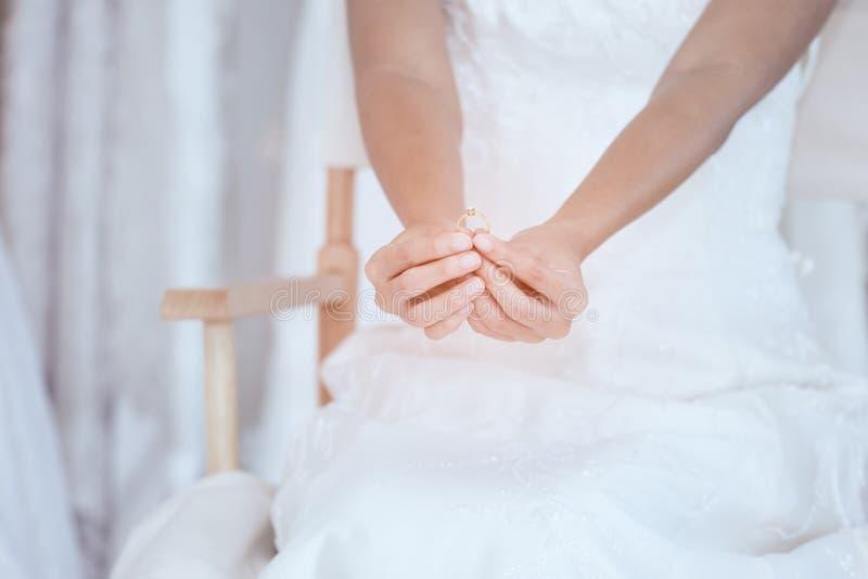 Close up of bride hand holding wedding diamond ring royalty free stock image