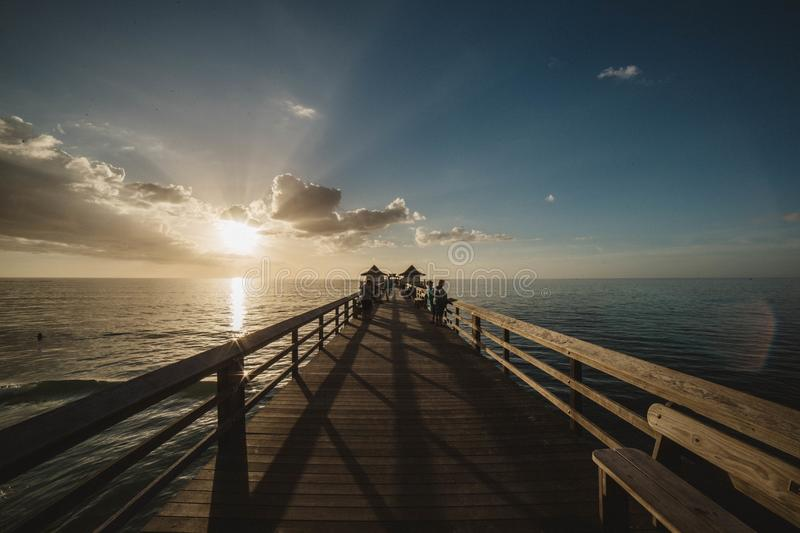 Close-up of Bridge over Sea at Sunset stock image
