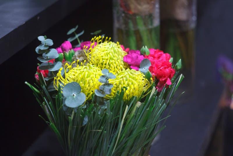 Close-up bright bouquet of seasonal flowers, chrysanthemum, tulip, eucalyptus, carnation, selective focus. Close up bright bouquet of seasonal flowers royalty free stock photo