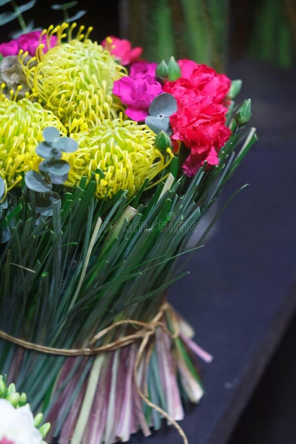 Close-up bright bouquet of seasonal flowers, chrysanthemum, tulip, eucalyptus, carnation, selective focus. Close up bright bouquet of seasonal flowers royalty free stock photography