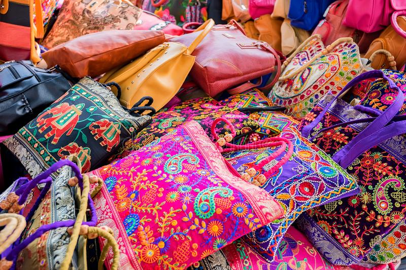 Range of colorful ethnic bags on Indian market stock images