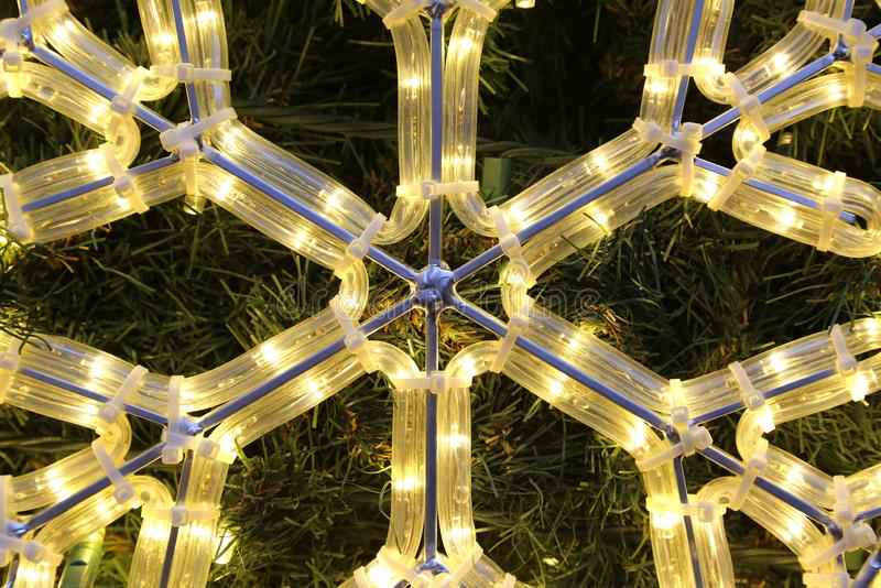 Close-up of bright glowing led christmas snowflake. Beautiful christmas decoration, close-up of bright glowing led snowflake royalty free stock photos