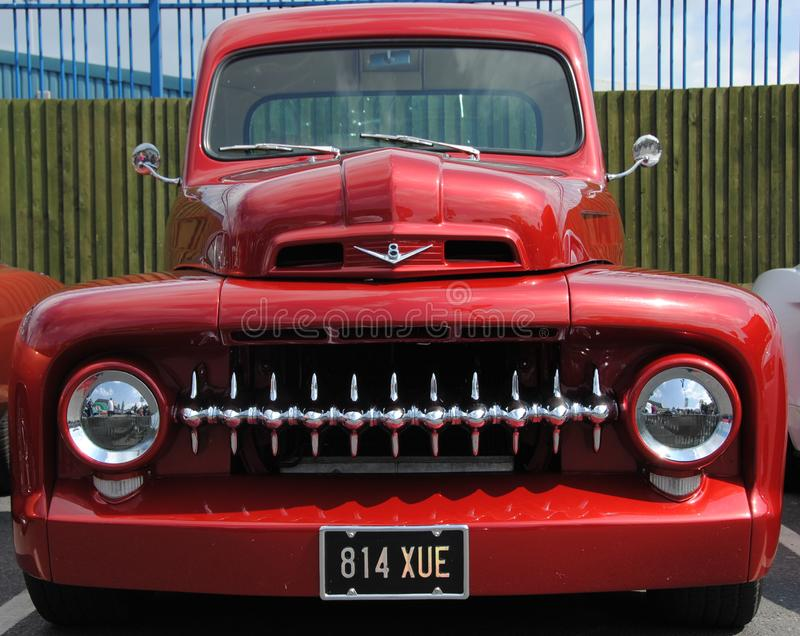 Close up of a bright red 1960s American pick up truck. Agressive in your face royalty free stock photos