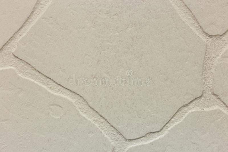 Close-up of bright white plastered uneven stucco wall. Abstract texture, chaotic copy space background. Decorative grunge space stock photography