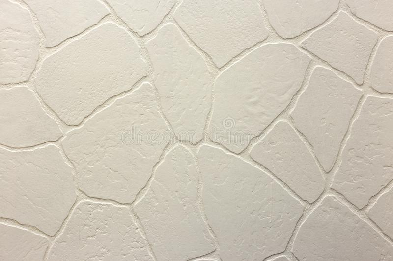 Close-up of bright white plastered uneven stucco wall. Abstract texture, chaotic copy space background. Decorative grunge space royalty free stock photo