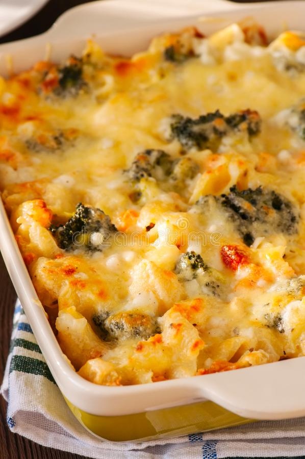 Close up of broccoli and pumpkin mac and cheese in a ceramic dis royalty free stock photos
