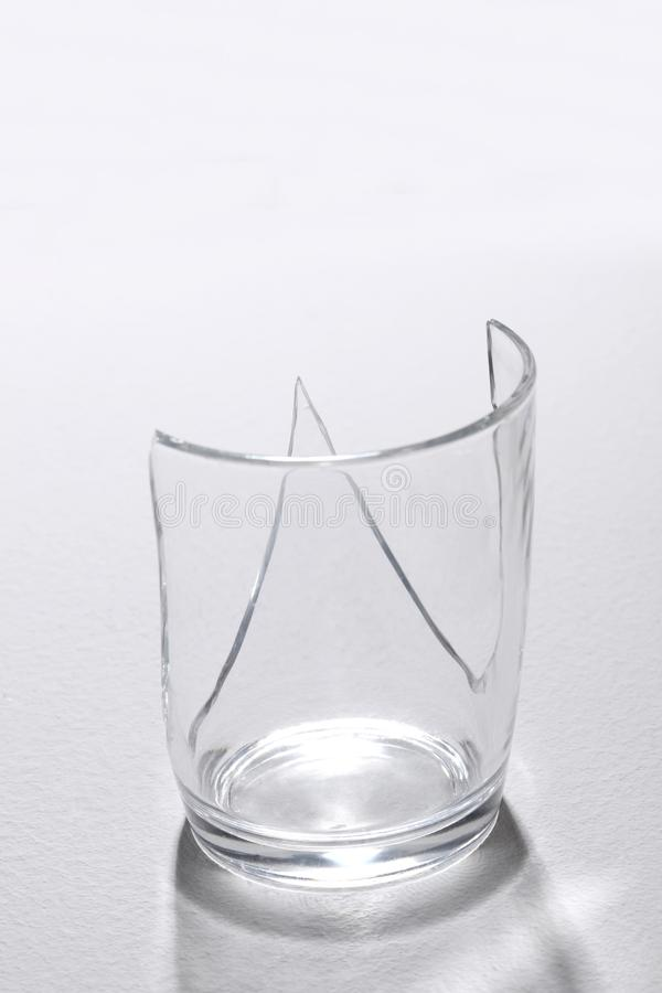 Close up on a broken glass on white background. Close up on a broken glass white background royalty free stock images