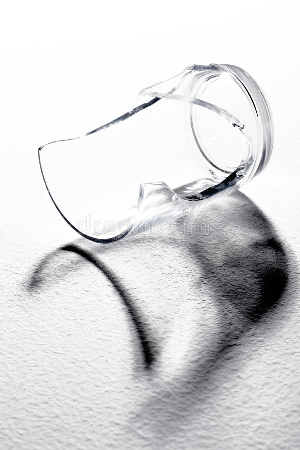 Close up on a broken glass on white background. Close up on a broken glass white background stock photo