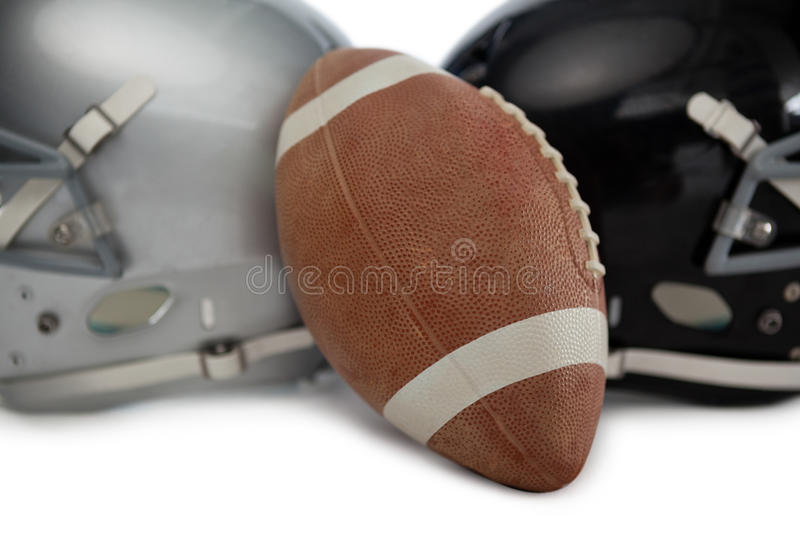 Close up of brown American football with sports helmet. On white background royalty free stock photography