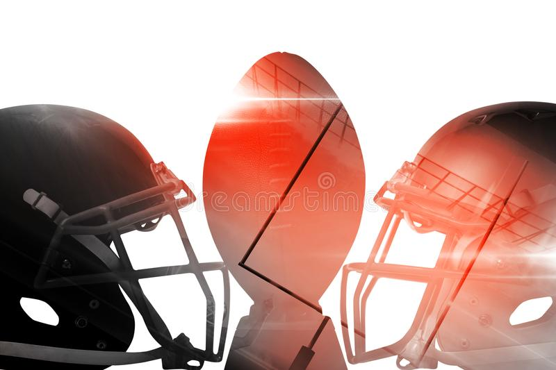 Close up of brown American football on tee by sports helmets. Against white baclground stock photo