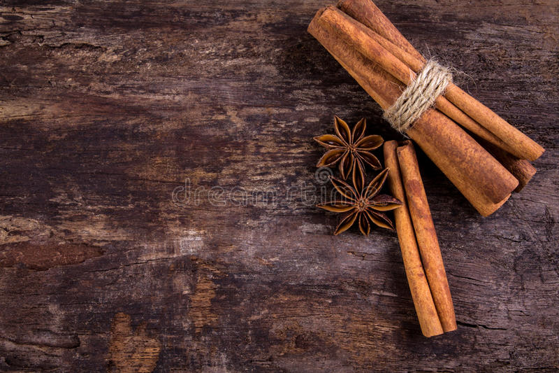 Close up the brown Cinnamon and Star Anise spice with copy space. Close up brown Cinnamon and Star Anise spice with copy space on wooden background stock photography
