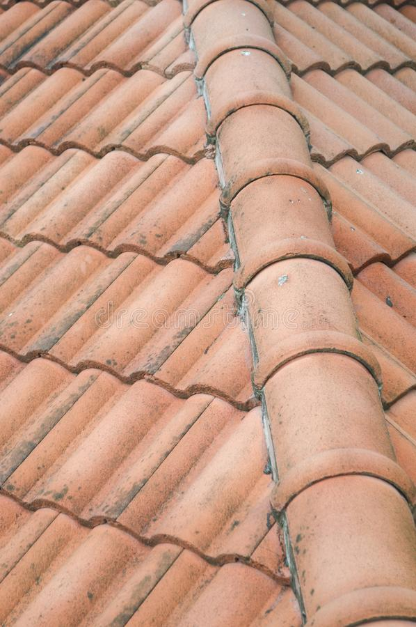 Brown clay roof tiles. Close up of the brown clay roof tiles royalty free stock image