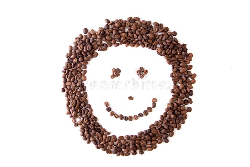 Close up brown coffee bean smiley grains, isolated on white. Background royalty free stock image