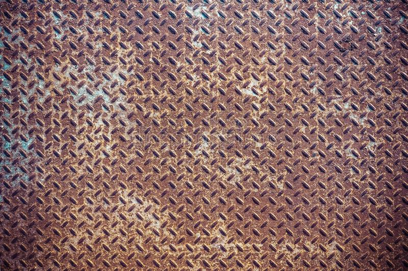 Close up of grunge rusty diamond metal plate abstract background. Close up of brown grunge rusty diamond metal plate abstract background stock images