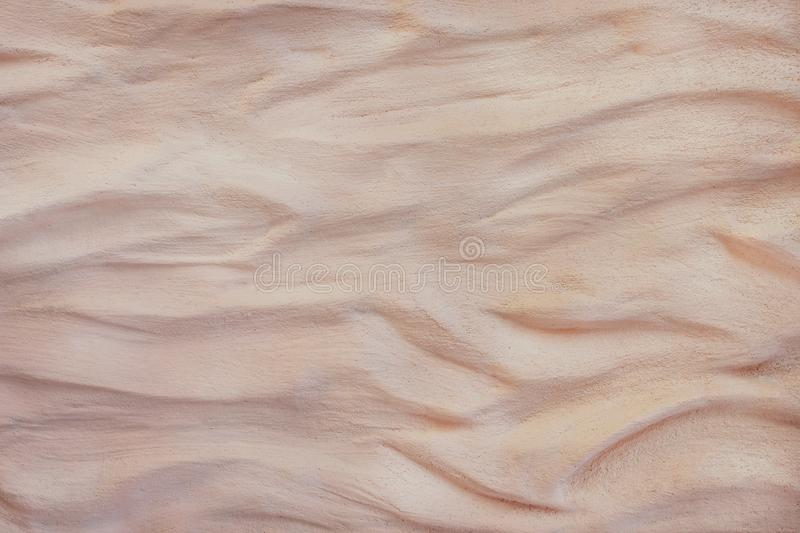 Brown plastering the concrete wall texture in wave seamless rough patterns ,white or gray art abstract background royalty free stock image