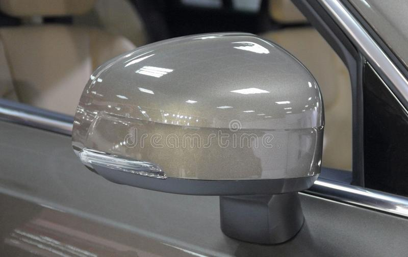 The close up of brown rear view mirror of SUV. stock image