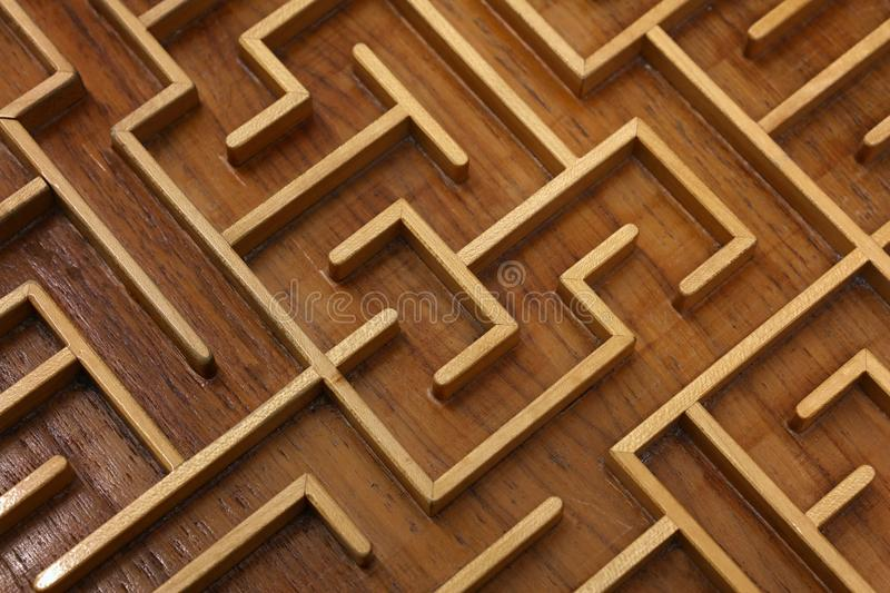 Wooden labyrinth maze puzzle close up. Close up of brown wooden labyrinth maze, toy puzzle game, elevated high angle view royalty free stock photos