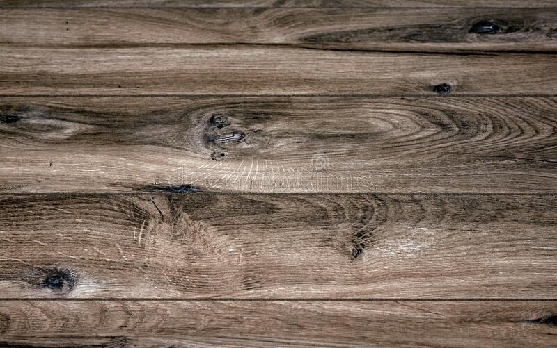 Close-up brown wooden planks and texture with wood grain. Structured background royalty free stock images