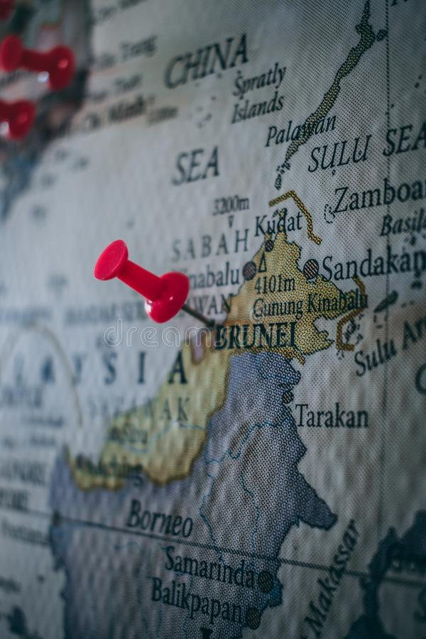 Close up of Brunei pin pointed on the world map with a pink pushpin royalty free stock photography