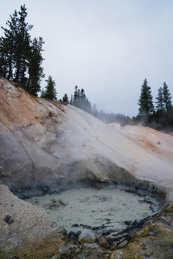 Close up of a bubbling mud pot in the Sulphur Works area of Lassen Volcanic National Park, a geothermal feature.  stock photo