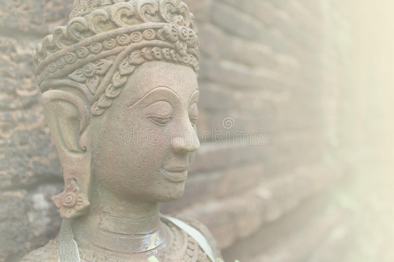 Close up of Buddha face statue in soft color royalty free stock photo