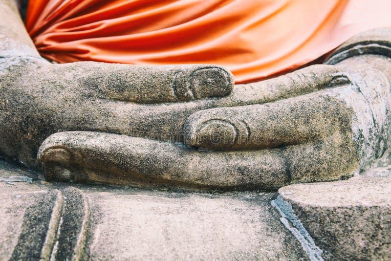 Close up of buddha hands Wat Yai Chaimongkhon, Ayuthaya, Thailand. Close up hands of buddha statue Wat Yai Chaimongkhon, temple in ancient Thai capital Ayuthaya royalty free stock photos