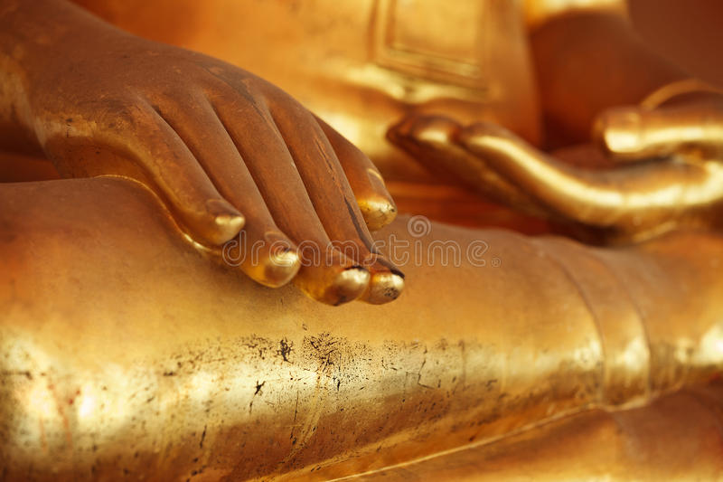 Close-up of Buddha statue. Palm in golden color royalty free stock photos