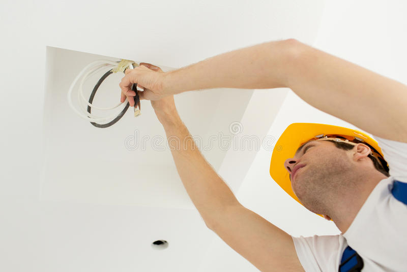Close up of builder or electrician running wires royalty free stock photos