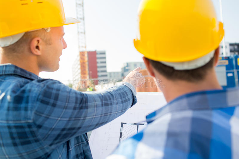 Close up of builders with blueprint at building stock photo image download close up of builders with blueprint at building stock photo image of holding malvernweather Choice Image