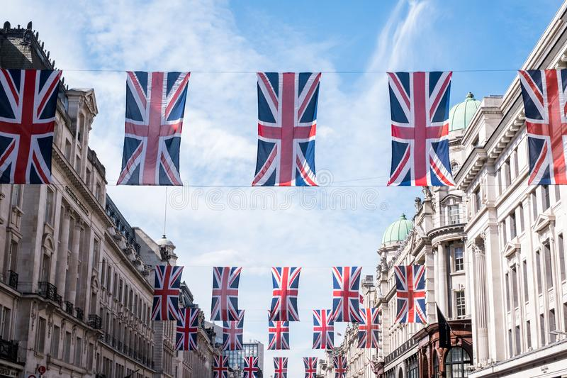 Close up of buildings on Regent Street London with row of British flags to celebrate the wedding of Prince Harry to Meghan Markle. London UK. Close up of stock images