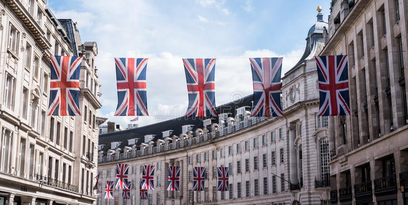 Close up of buildings on Regent Street London with row of British flags to celebrate the wedding of Prince Harry to Meghan Markle royalty free stock photo