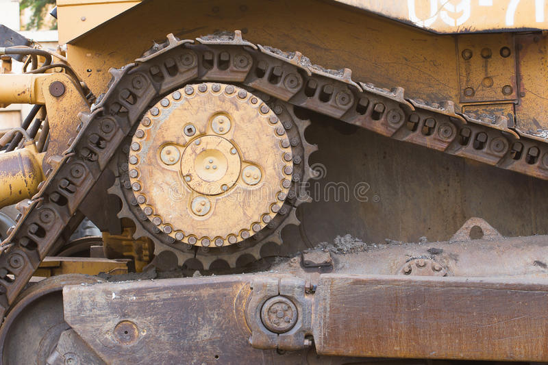 Close up bulldozer in construction site. Close up Part of bulldozer track in construction site royalty free stock images