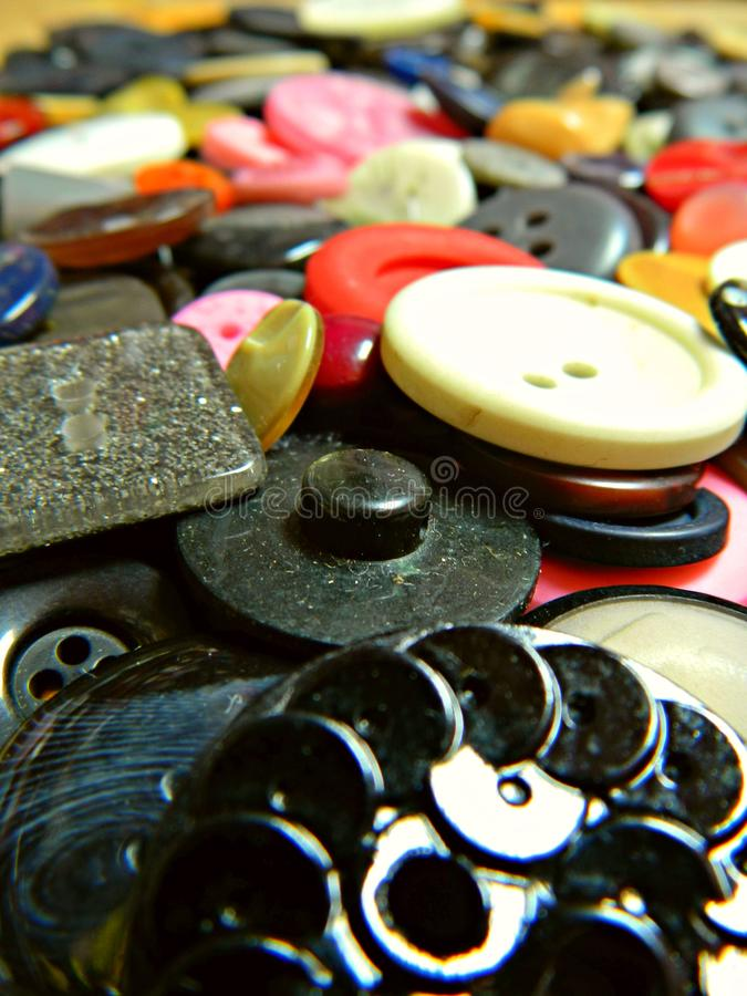 Close up of a bunch of colorful buttons royalty free stock image